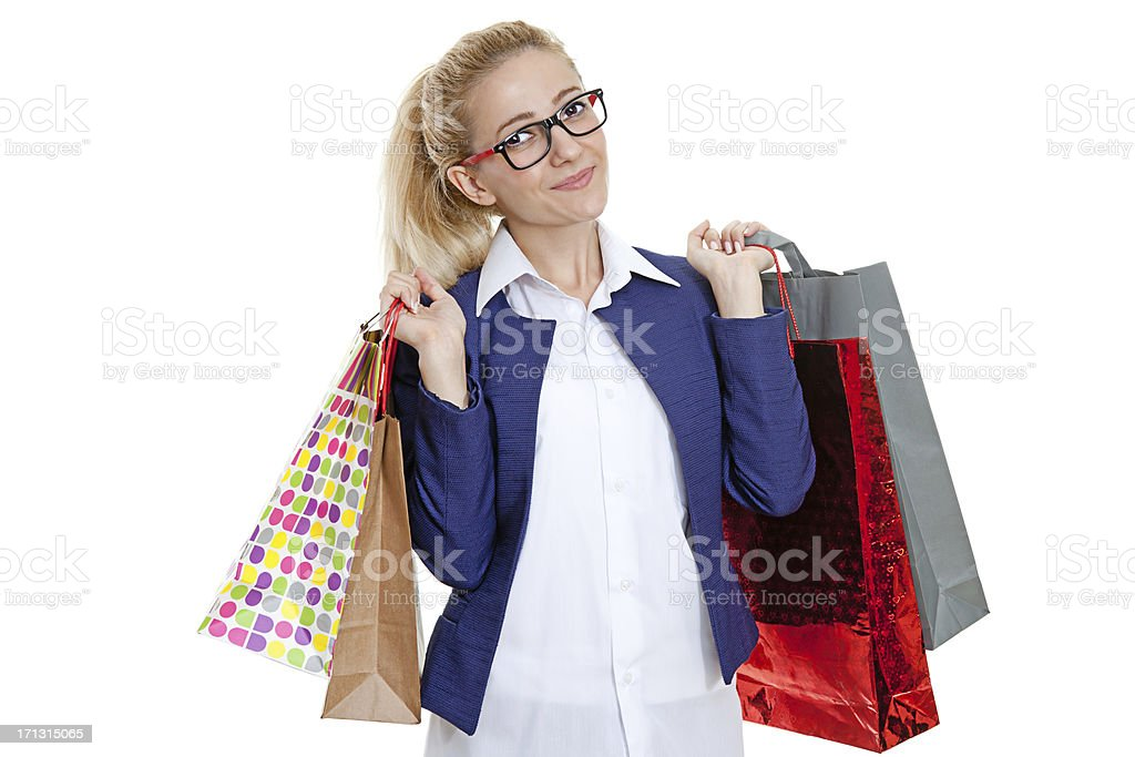 Businesswoman holding shopping bags on white background royalty-free stock photo
