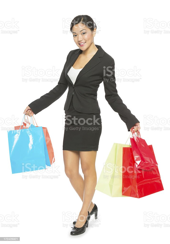 Businesswoman Holding Shopping Bags royalty-free stock photo