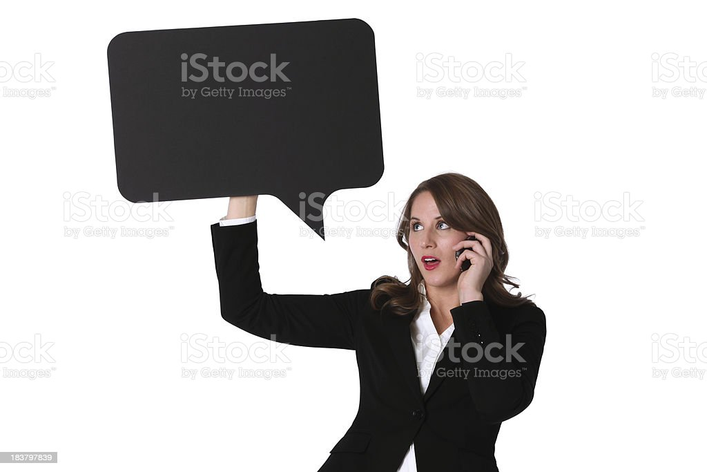 Businesswoman holding speech bubble and talking on mobile phone royalty-free stock photo