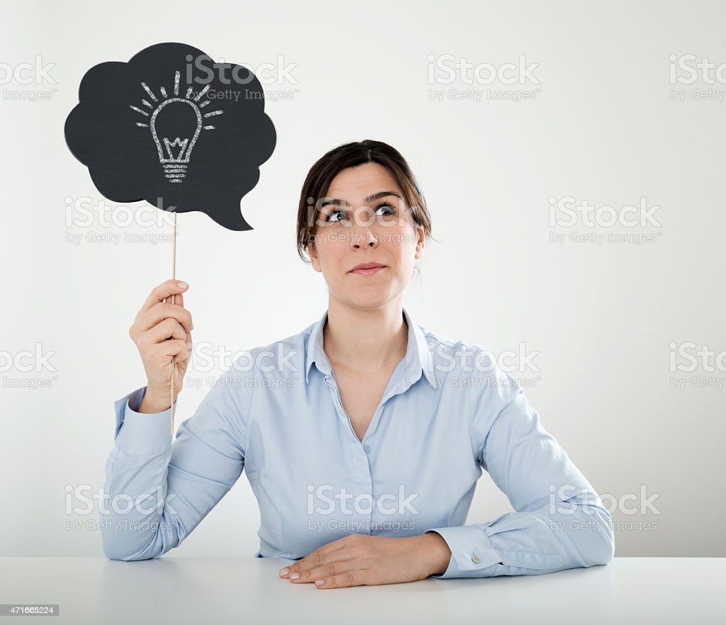 businesswoman holding speech bubble sign stock photo