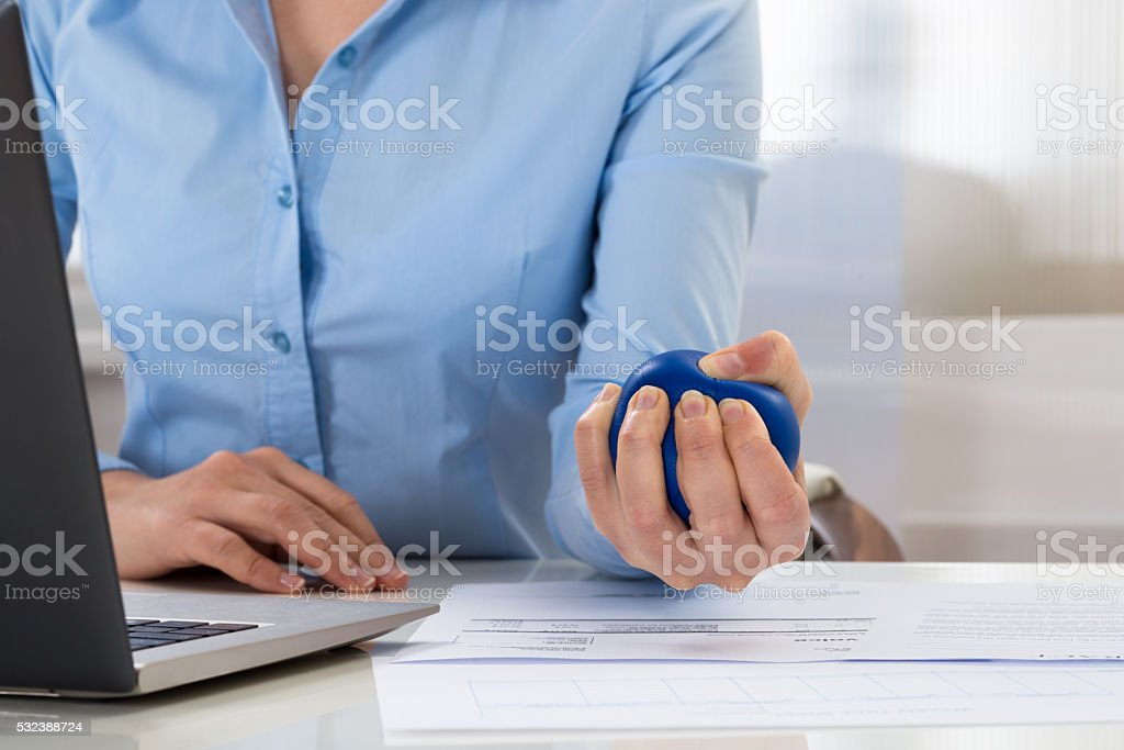 Businesswoman Holding Stress Ball stock photo