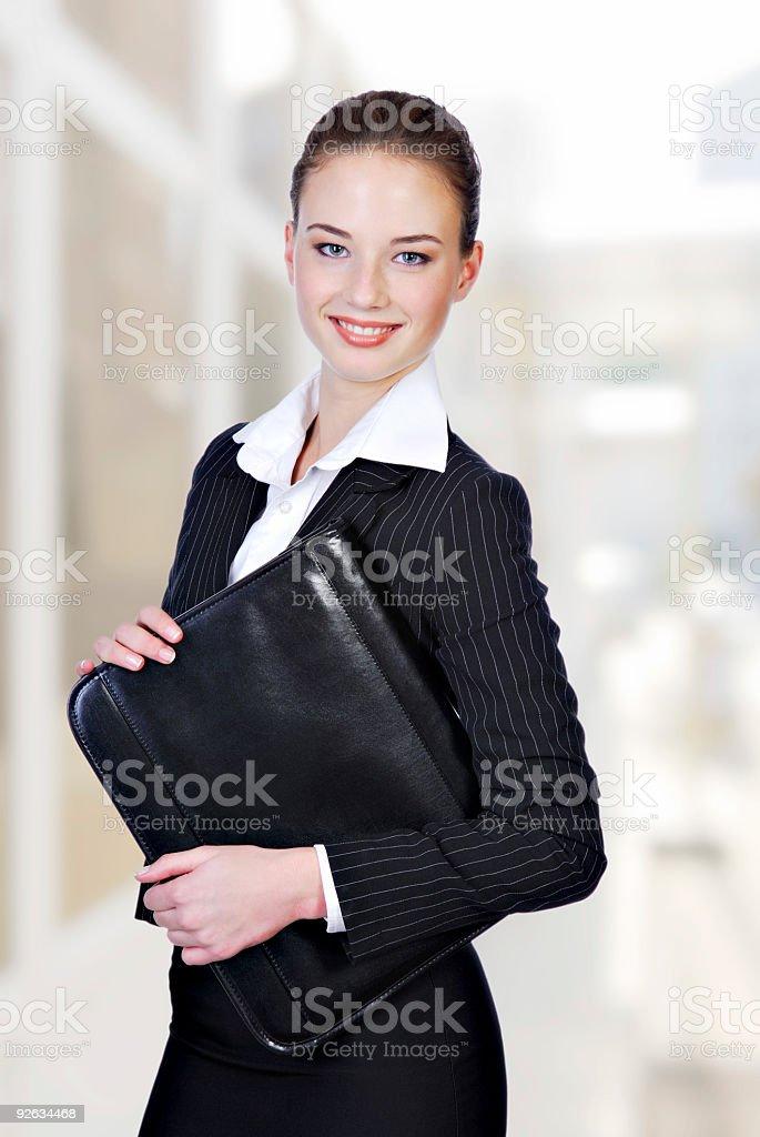 businesswoman holding the black folder royalty-free stock photo