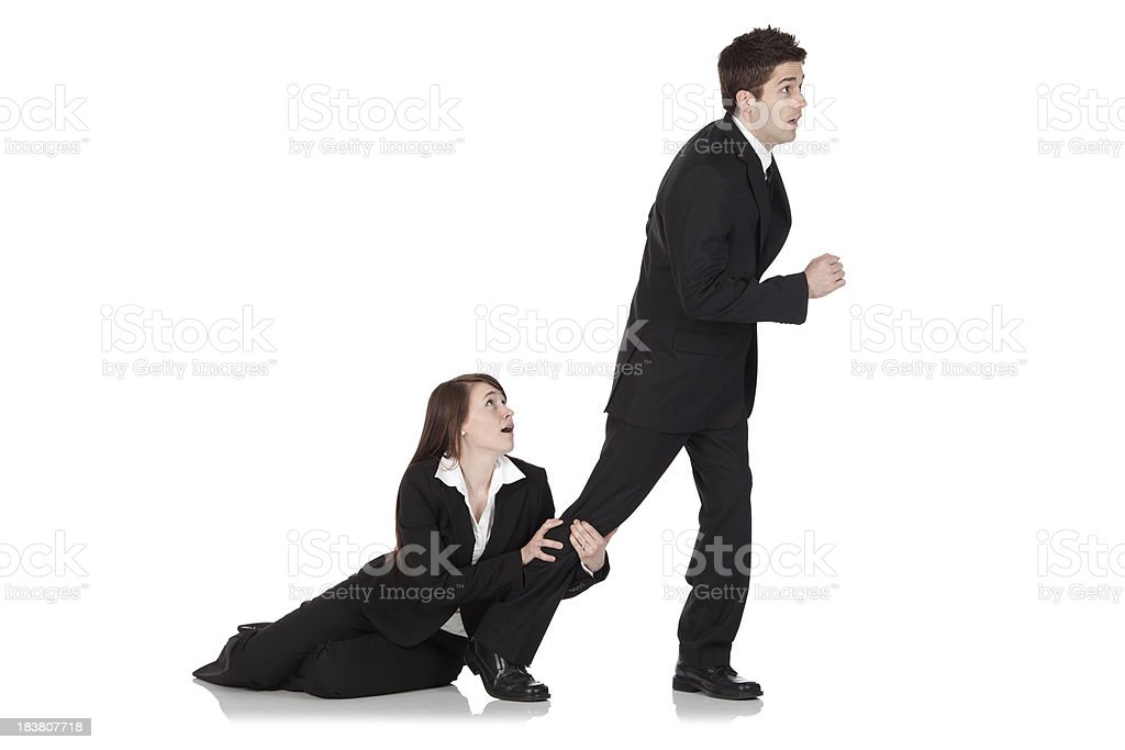 Businesswoman holding the leg of a businessman royalty-free stock photo