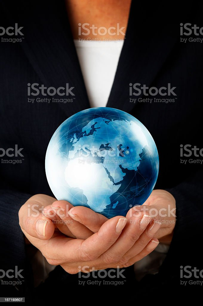Businesswoman holding the world in her hands stock photo