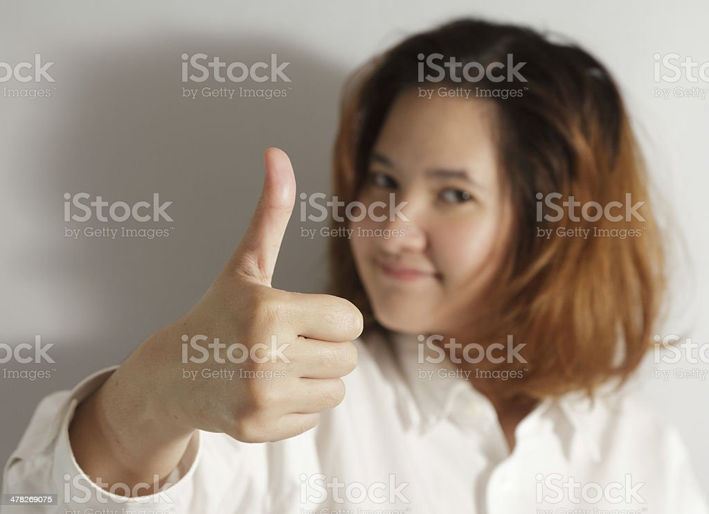 businesswoman holding thumps up royalty-free stock photo