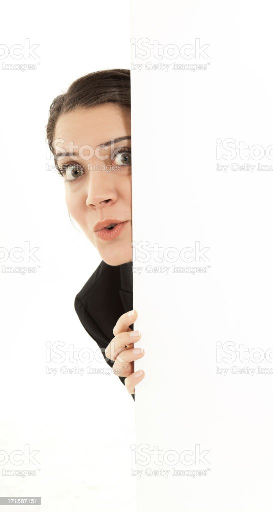 Businesswoman holding white board. Isolated stock photo