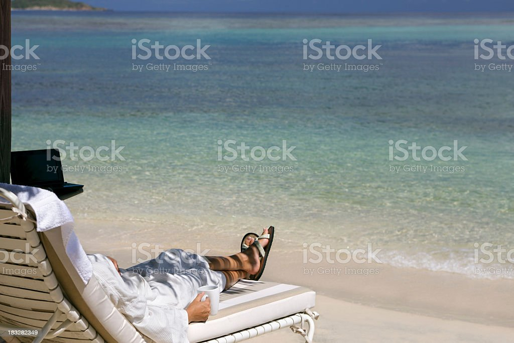 businesswoman in a robe with morning coffee at the beach royalty-free stock photo