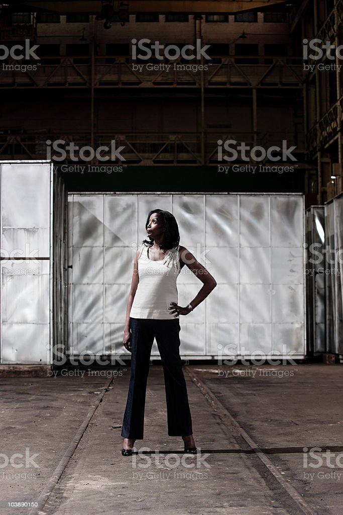 Businesswoman in a warehouse stock photo