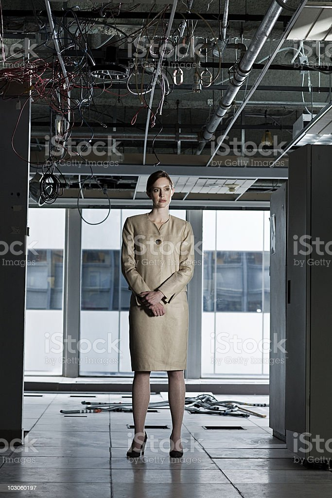 Businesswoman in abandoned office royalty-free stock photo