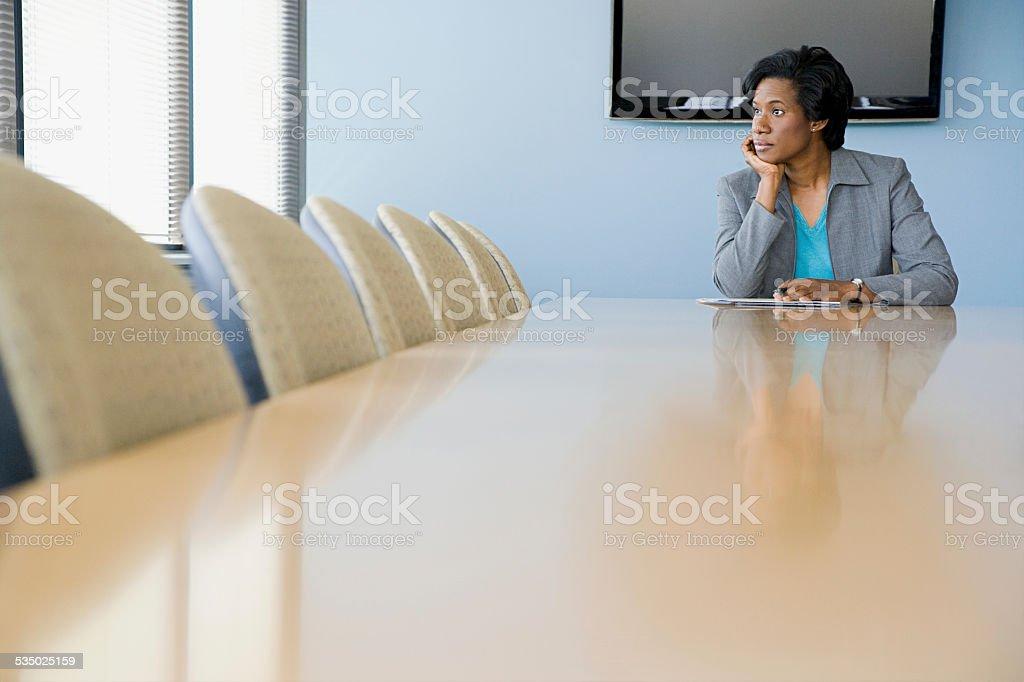 Businesswoman in boardroom stock photo