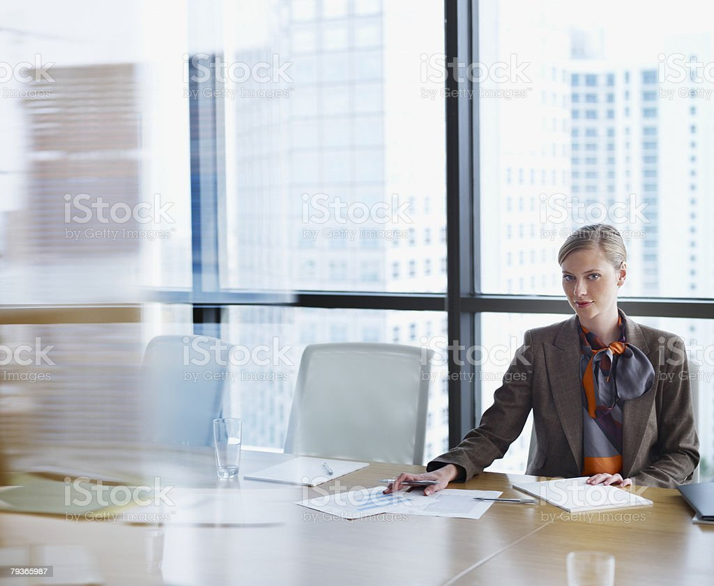 Businesswoman in boardroom with paperwork royalty-free stock photo