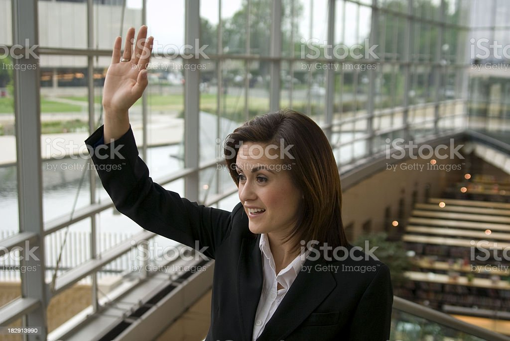 Businesswoman in Business Office Waving: Confident Woman Politican stock photo