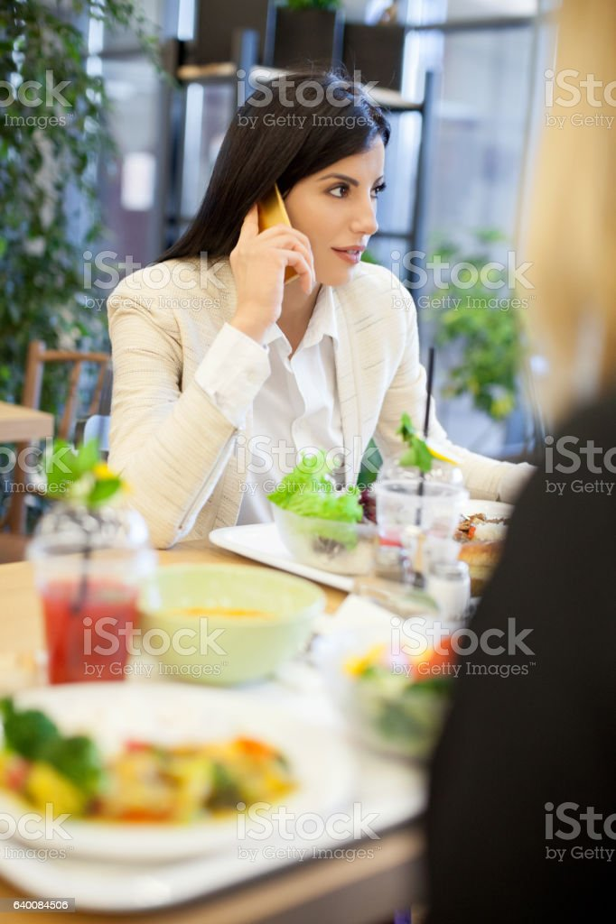 Businesswoman in cafe on the phone stock photo