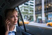 Businesswoman in car talking on phone