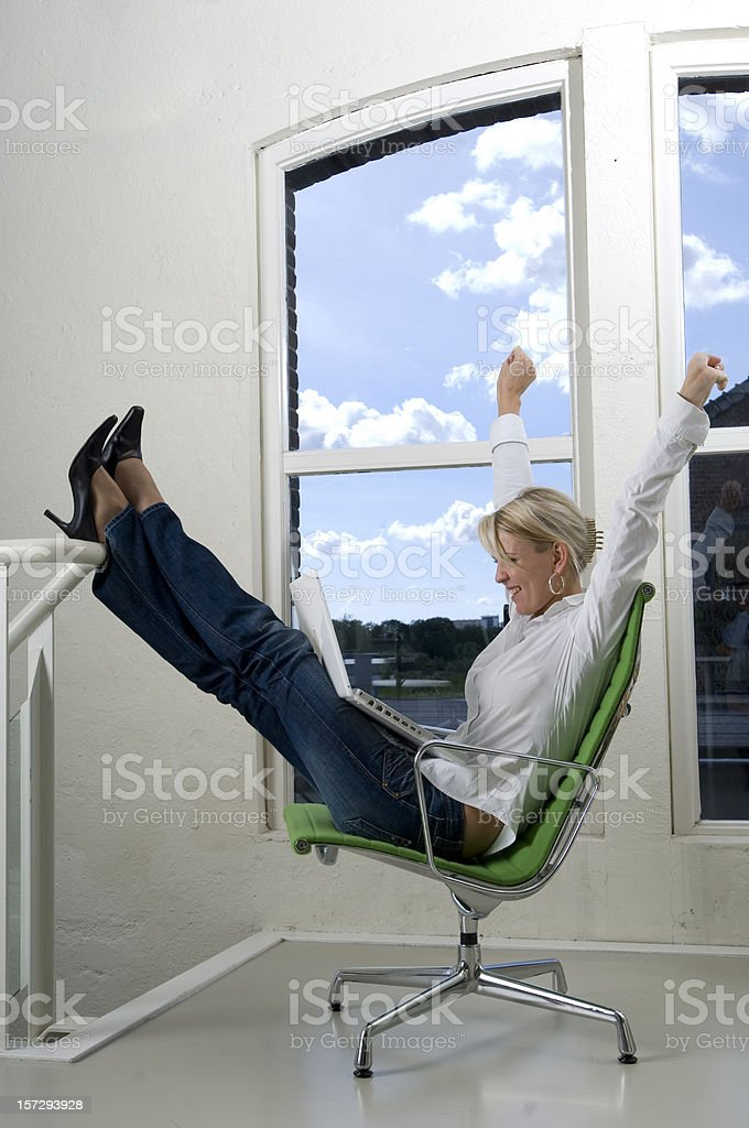 businesswoman in chair cheering royalty-free stock photo