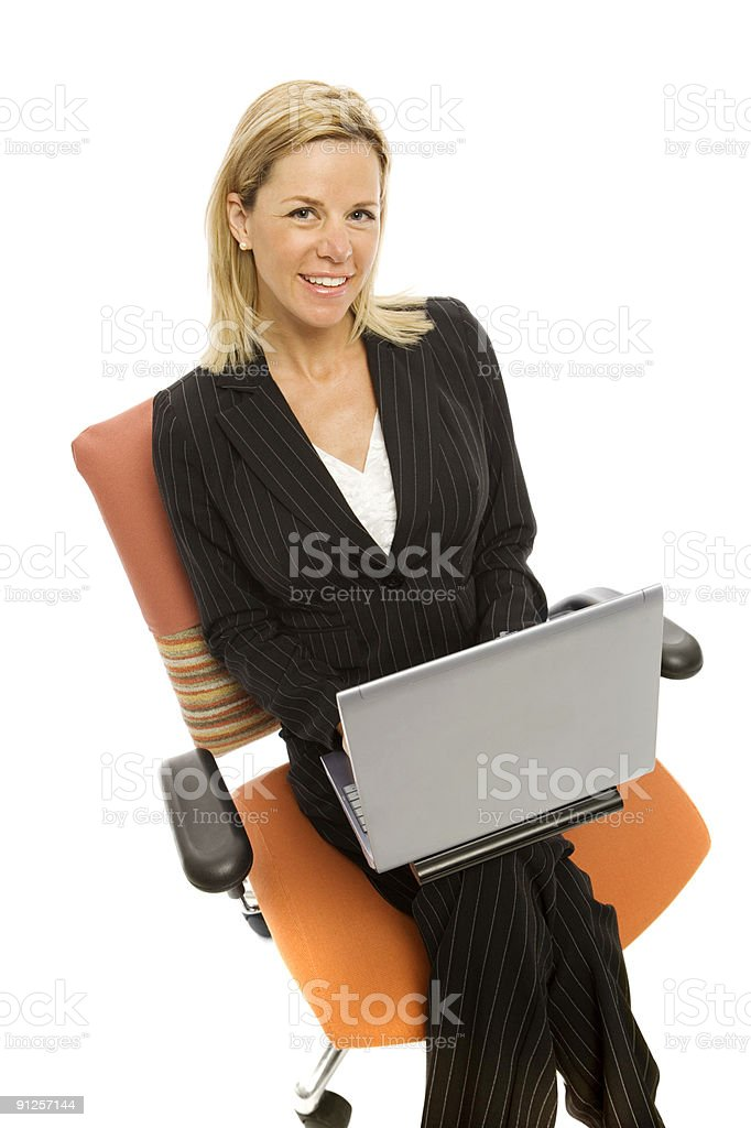 Businesswoman in chair with laptop royalty-free stock photo