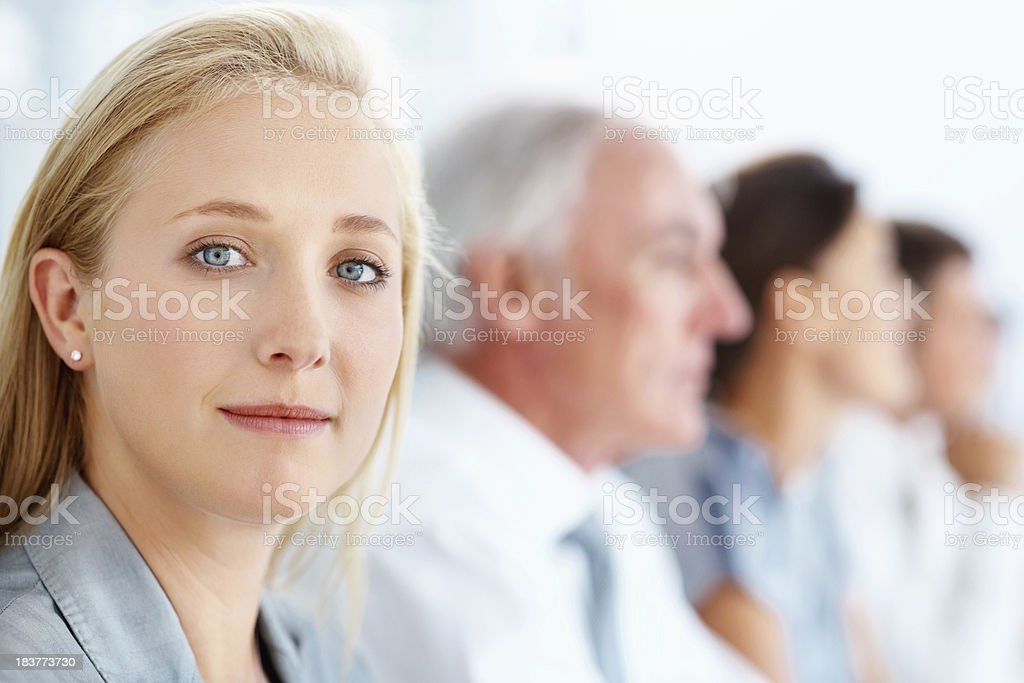 Businesswoman in conference with associates royalty-free stock photo
