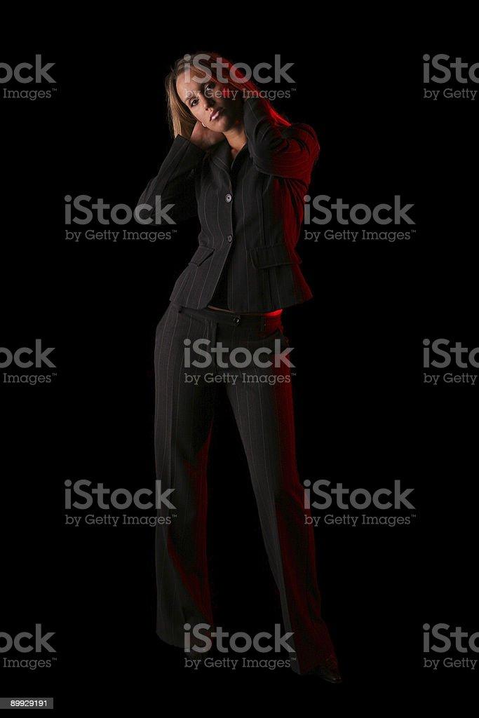 Businesswoman in dark royalty-free stock photo