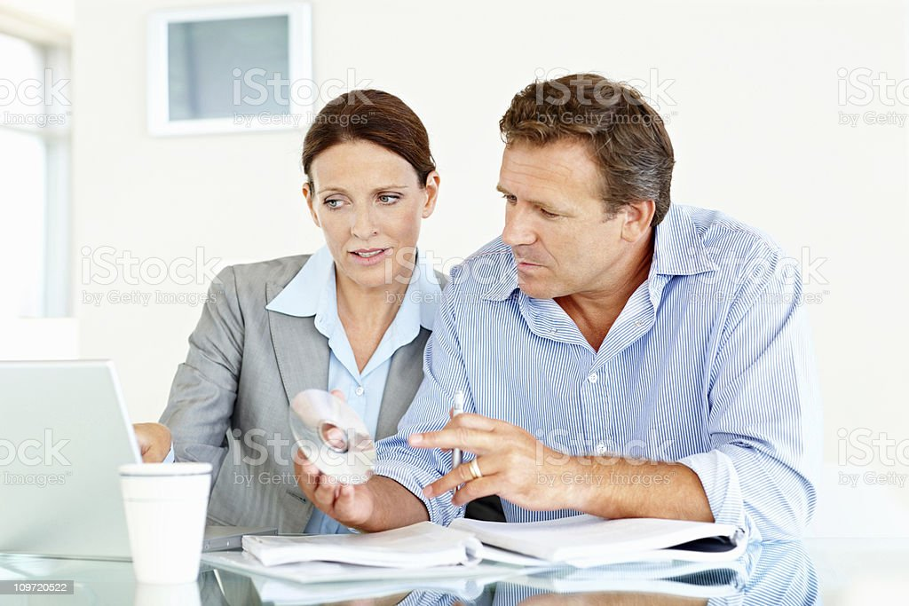 Businesswoman in discussion with colleague at work royalty-free stock photo