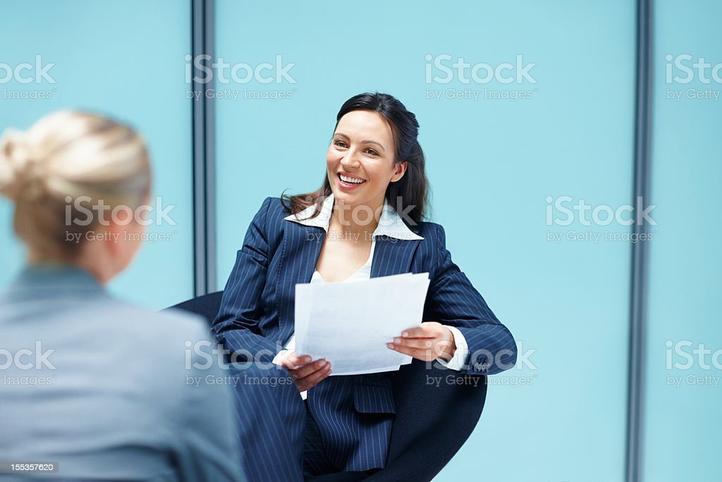Businesswoman in discussion with colleague royalty-free stock photo