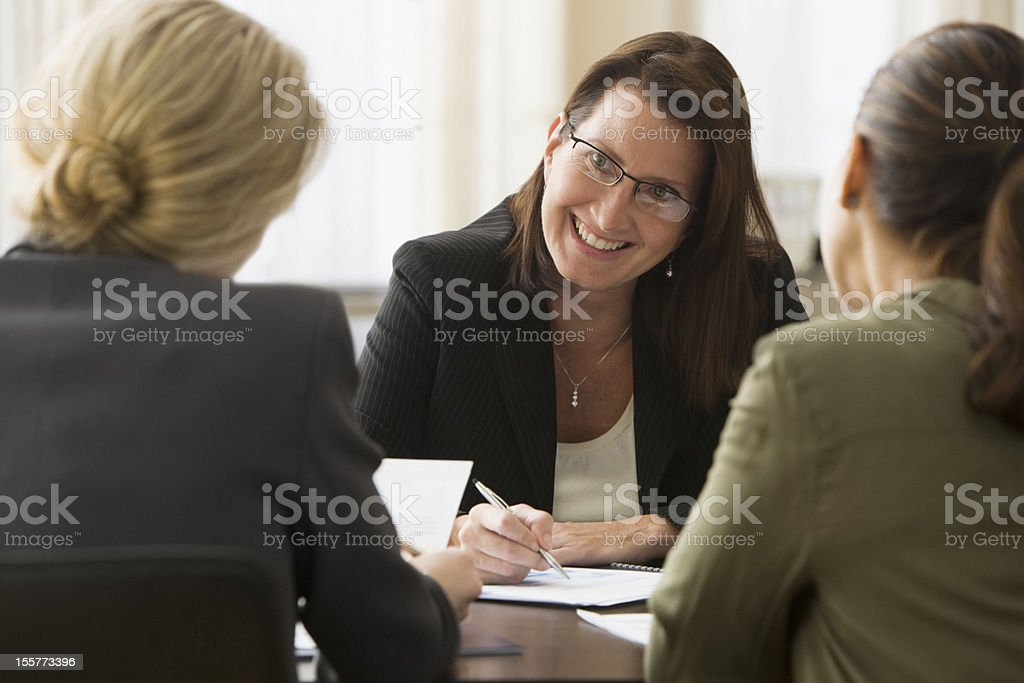Businesswoman in discussion with colleagues royalty-free stock photo