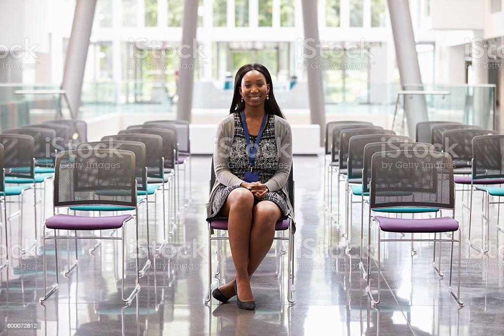 Businesswoman In Empty Auditorium Preparing To Make Speech stock photo