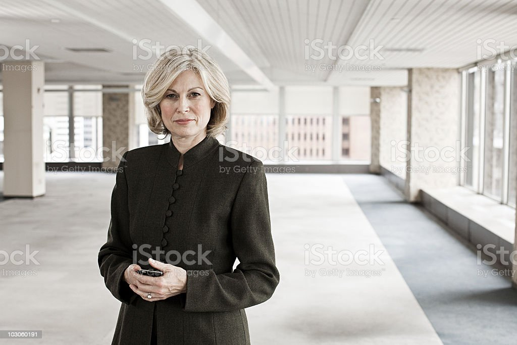 Businesswoman in empty office space stock photo