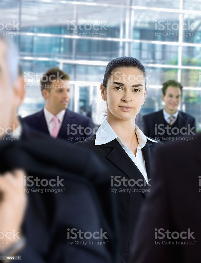 Businesswoman in front of office building stock photo