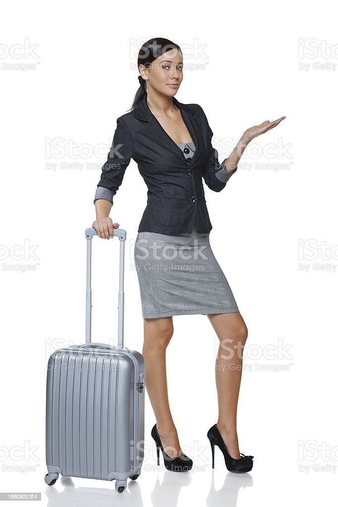 Businesswoman in full length with suitcase showing blank copy space stock photo