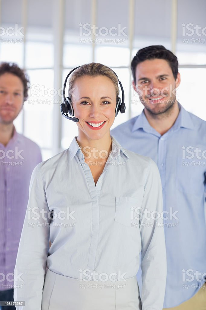 Businesswoman in headset with colleagues royalty-free stock photo