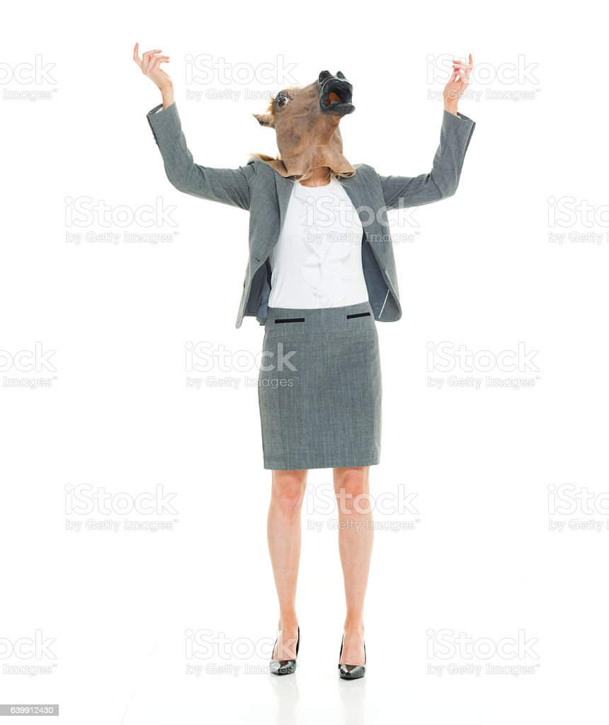 Businesswoman in horse costume and gesturing stock photo