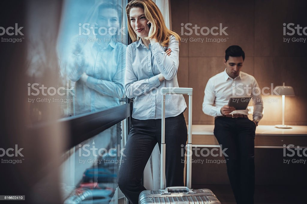 Businesswoman in hotel room stock photo