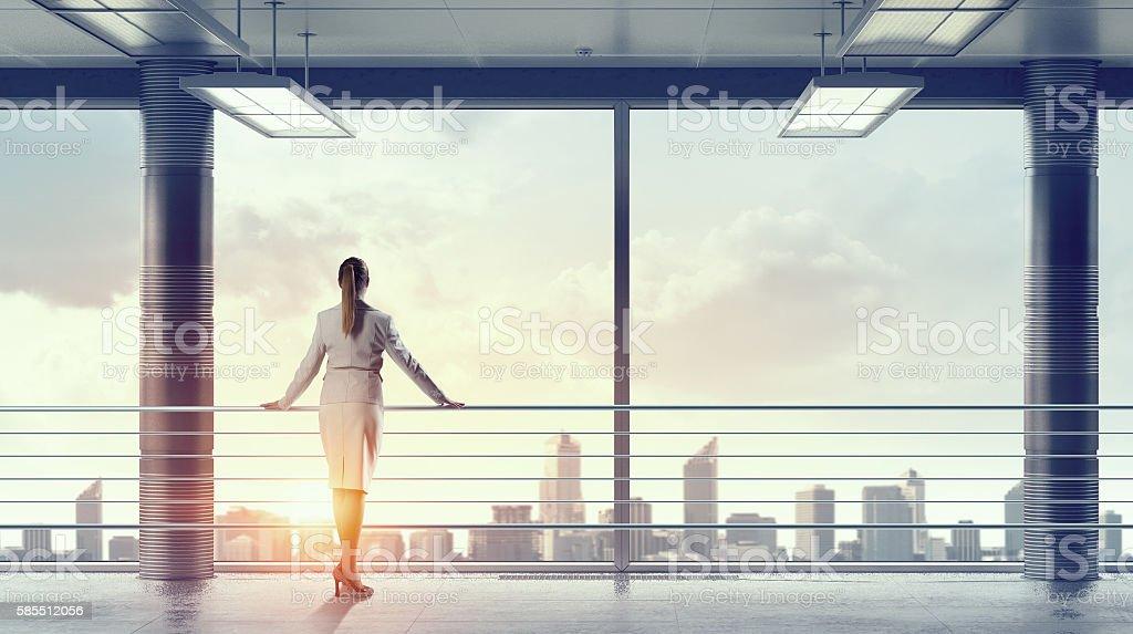 Businesswoman in modern office interior  . Mixed media stock photo