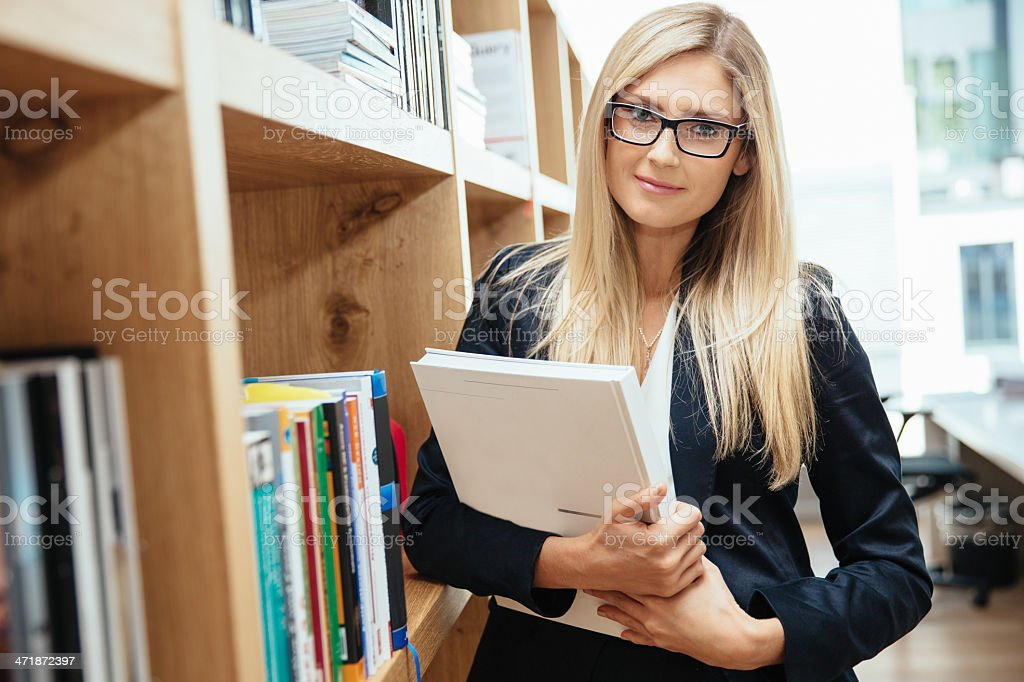 Businesswoman in Modern Office Interior with Book royalty-free stock photo