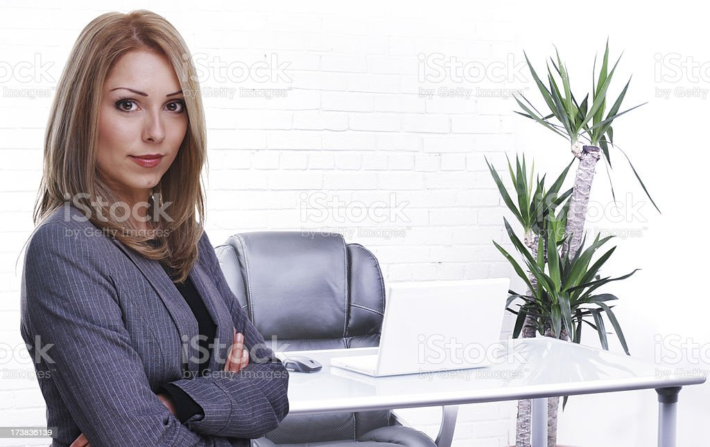 Businesswoman in office setting royalty-free stock photo