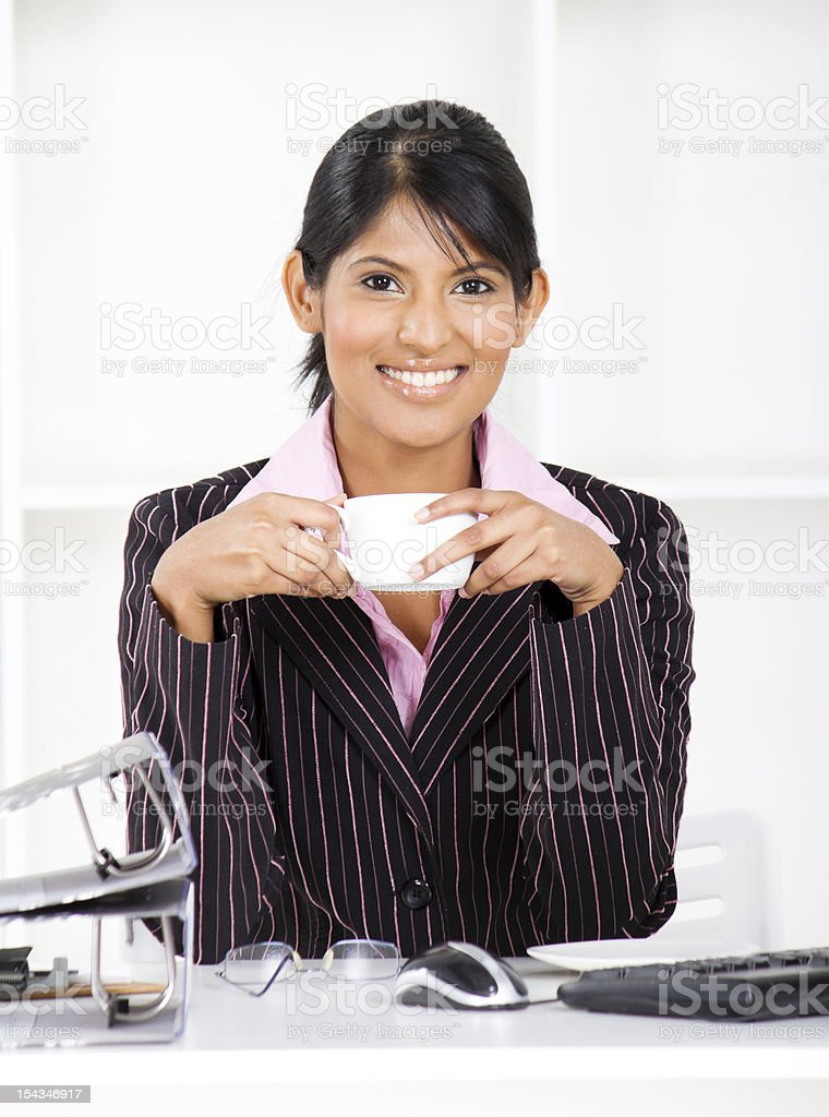 businesswoman in office with coffee royalty-free stock photo