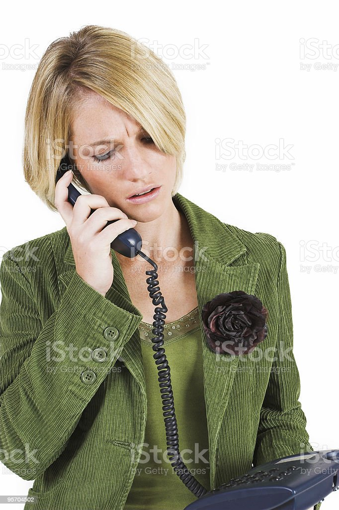 Businesswoman in olive green suit jacket using a phone royalty-free stock photo