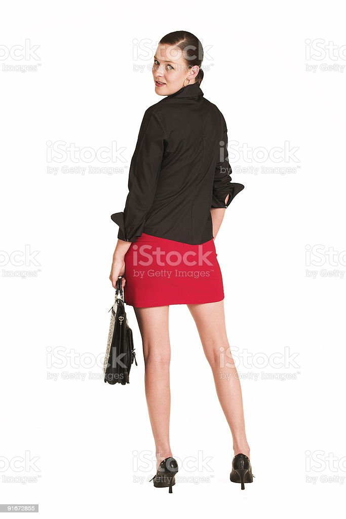 Businesswoman in red miniskirt with leather case royalty-free stock photo