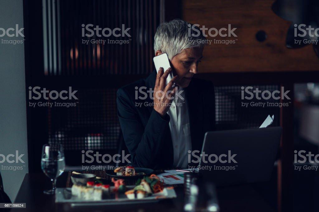 Businesswoman in restaurant stock photo