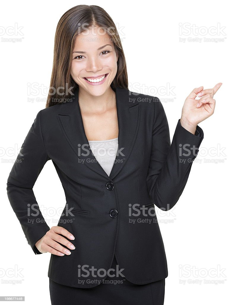 Businesswoman in suit pointing stock photo