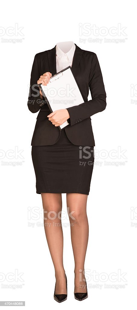 Businesswoman in suit without head, standing and holding clipboard. Isolated stock photo