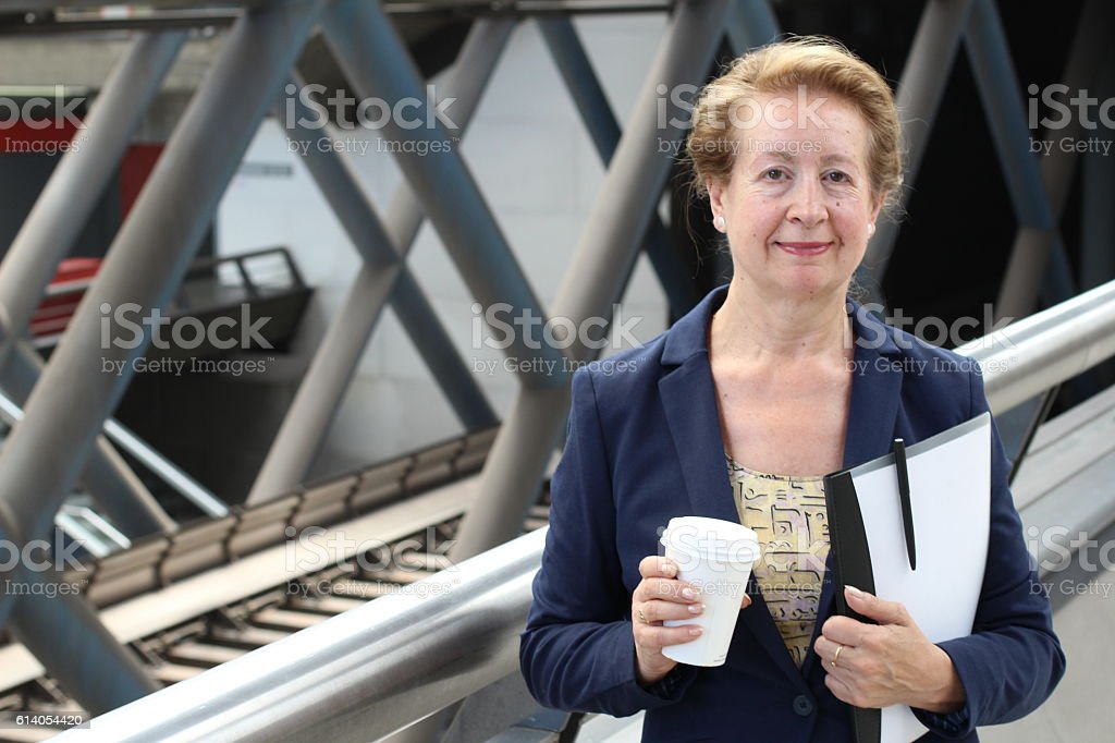 Businesswoman in the airport with copyspace stock photo