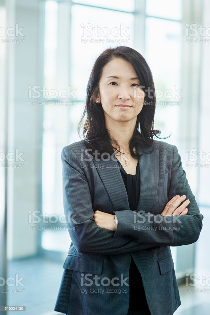 Businesswoman in the office lobby stock photo