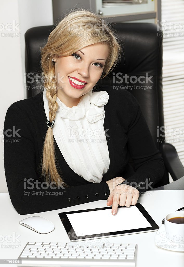 businesswoman in the office with ipad royalty-free stock photo