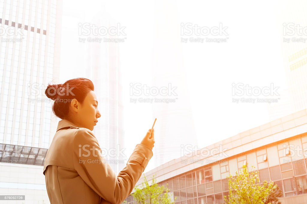 Businesswoman In Urban Landscape stock photo