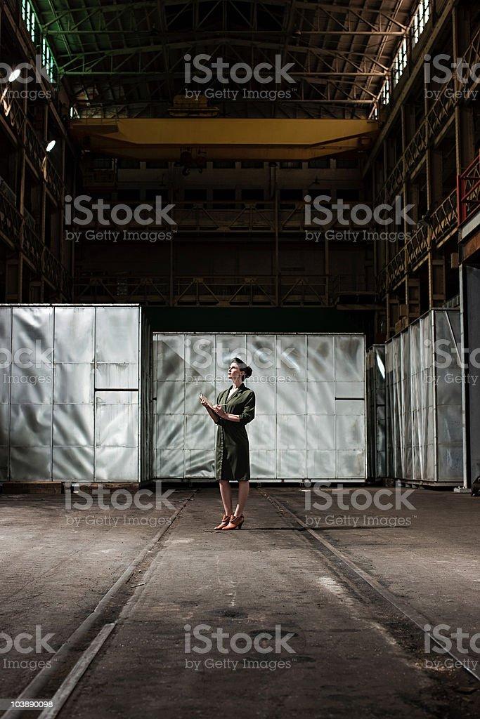 Businesswoman in warehouse stock photo