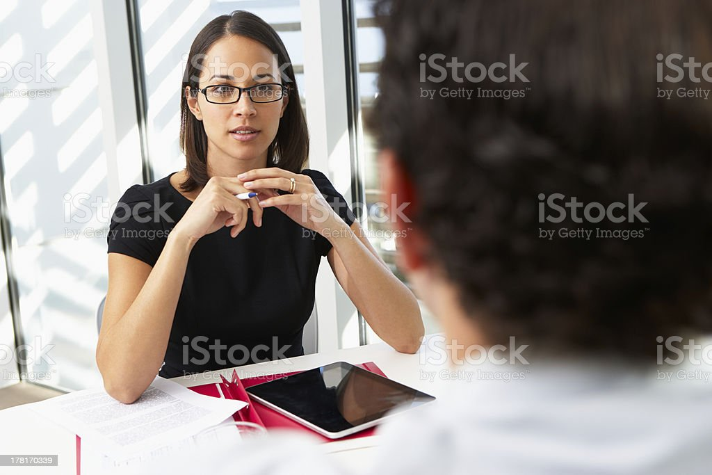 Businesswoman Interviewing Male Candidate For Job stock photo