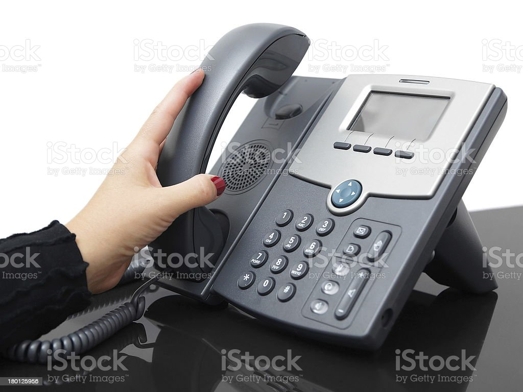 businesswoman is answering a phone royalty-free stock photo