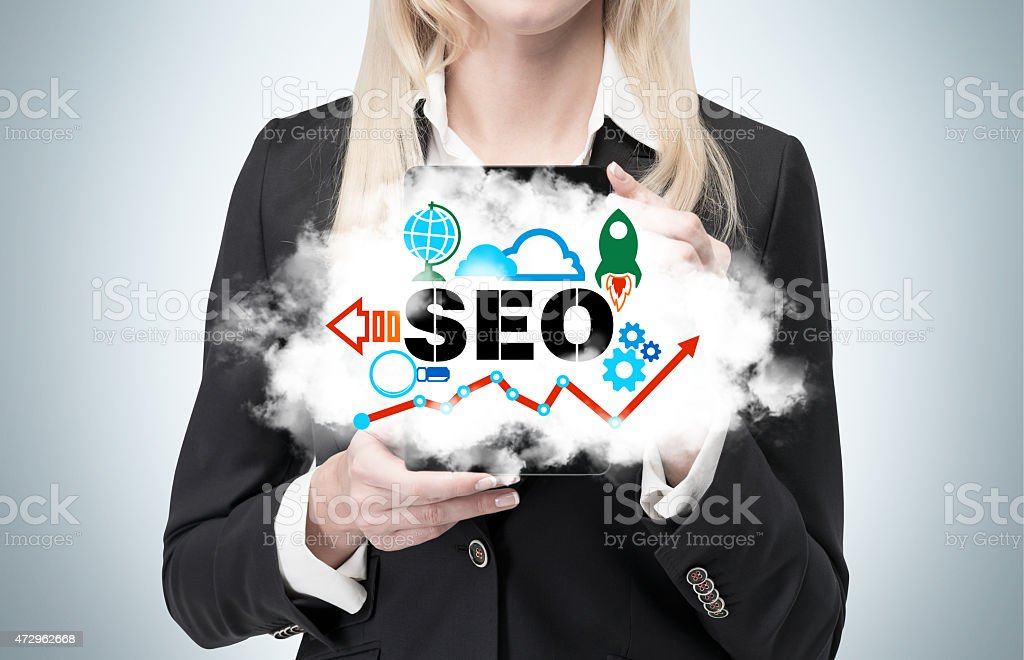 businesswoman is holding a cloud as a metaphor of 'SEO' stock photo