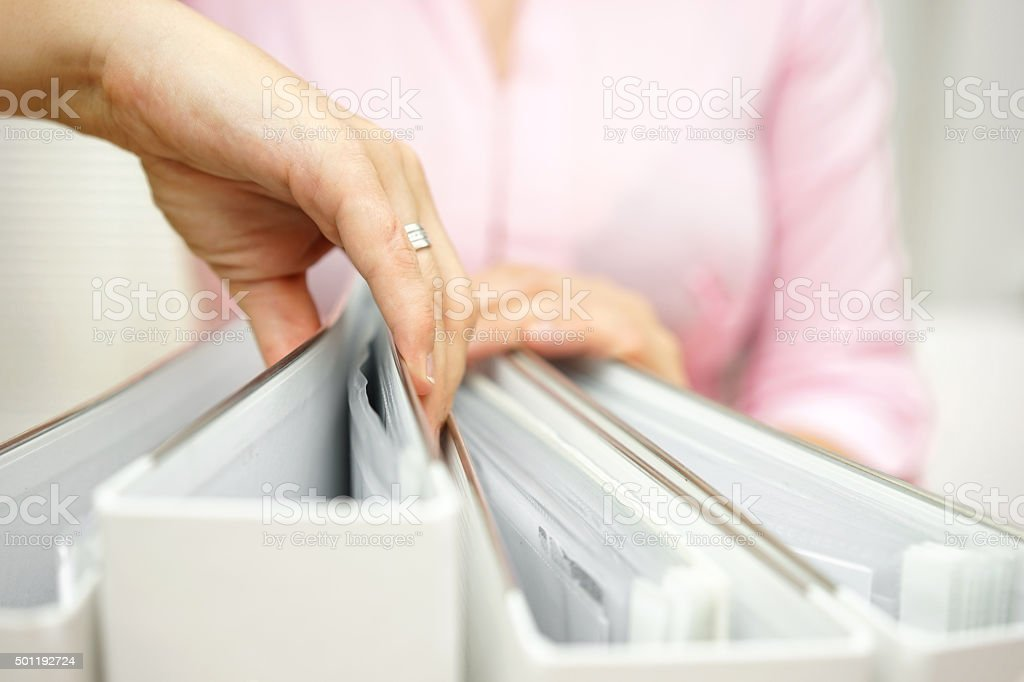 businesswoman is inspecting documentation stock photo